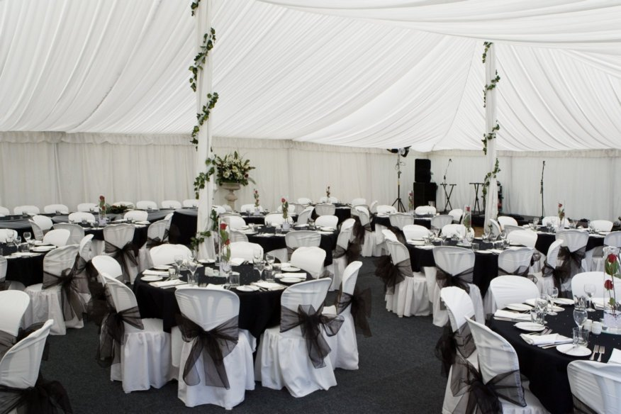 Black white party buffalo bounce house rentals for Black and white reception tables